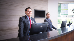 An image of hotel receptionists at the counter - guest relations sop