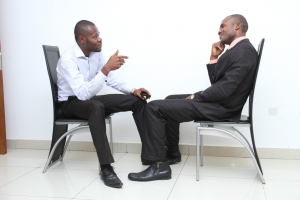 An image showing conversation between a senior and a junior employee - staff appraisal