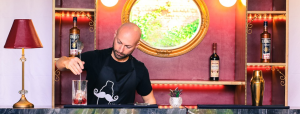 An image of a bartender mixing a cocktail - bar service sop