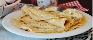 An image of plated pancakes - apple crepes